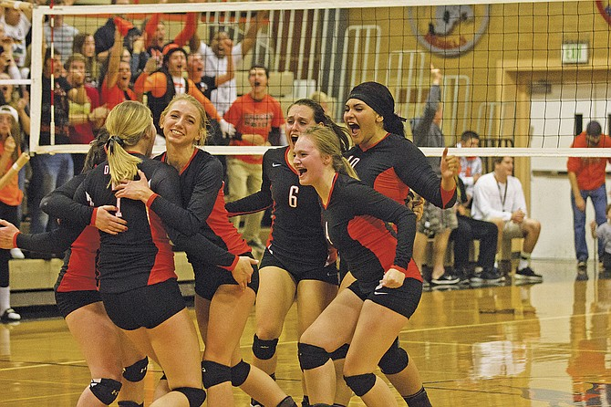 Dallas' Briana Classen, Amanda Dankenbring, Cambria Blair, Hailey Miller and Chanel Bailey celebrate after defeating North Eugene on Oct. 28.
