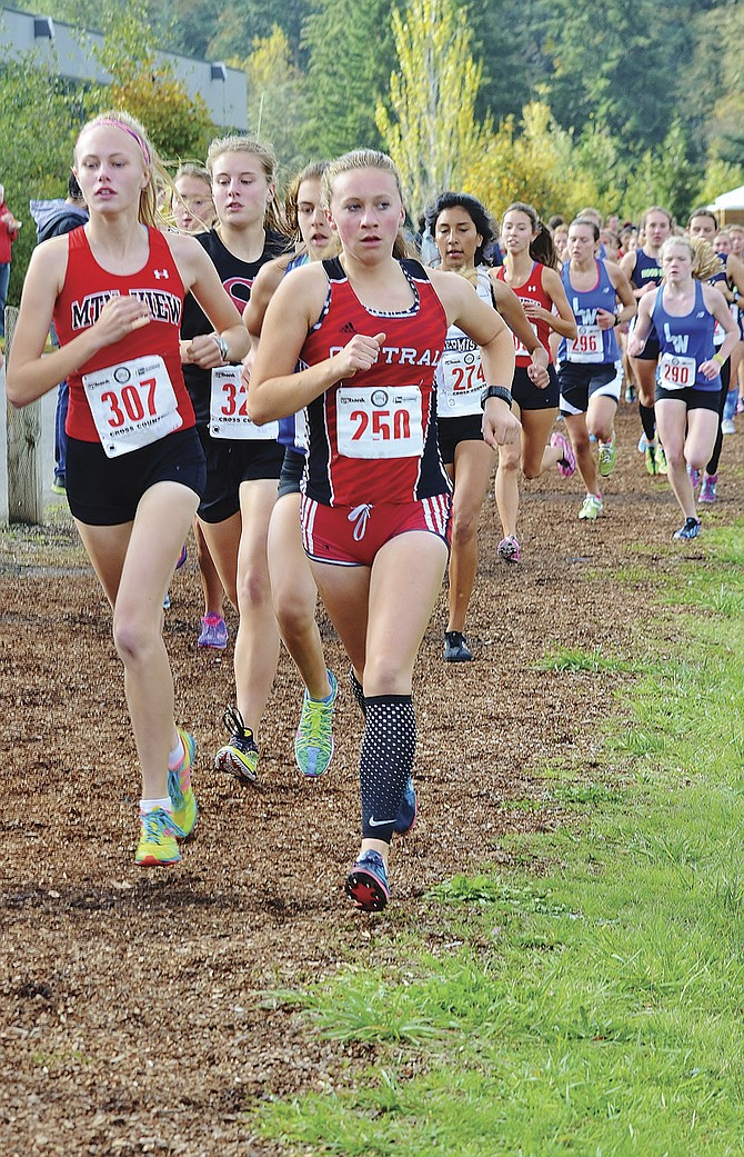 Central sophomore Abby McBeth (250) tries break away from a pack of runners on Saturday afternoon.