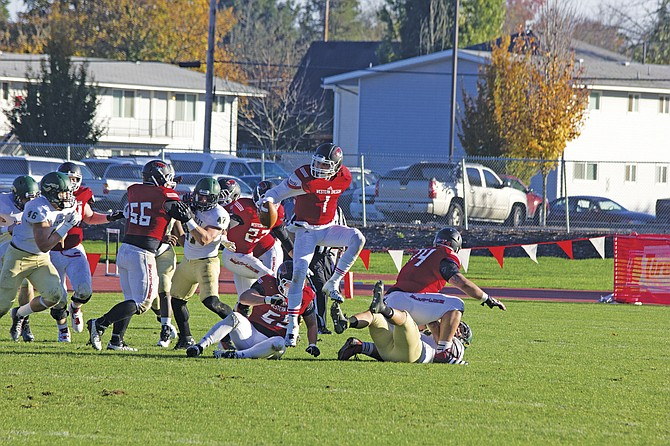 Western Oregon quarterback Ryan Bergman (1) escapes from pressure against Humboldt State on Saturday.