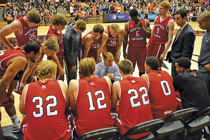 Wolves coach Brady Bergeson talks to Western Oregon during the Wolves' 57-47 win over Oregon State on Friday.