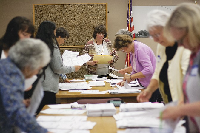Polk County Clerk Val Unger, center, answers a question the morning of the  Nov. 25 recount of the Polk County Board of Commissioners race.
