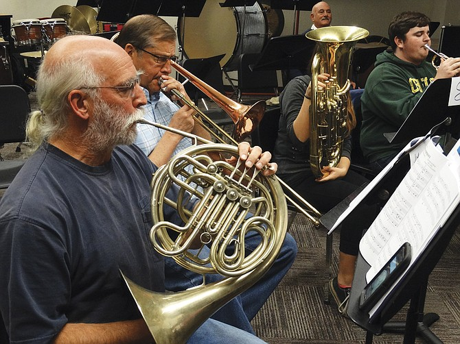 Gene Dershewitz, 67, plays the French horn in New Horizon's Orchestra with only a few weeks of experience.