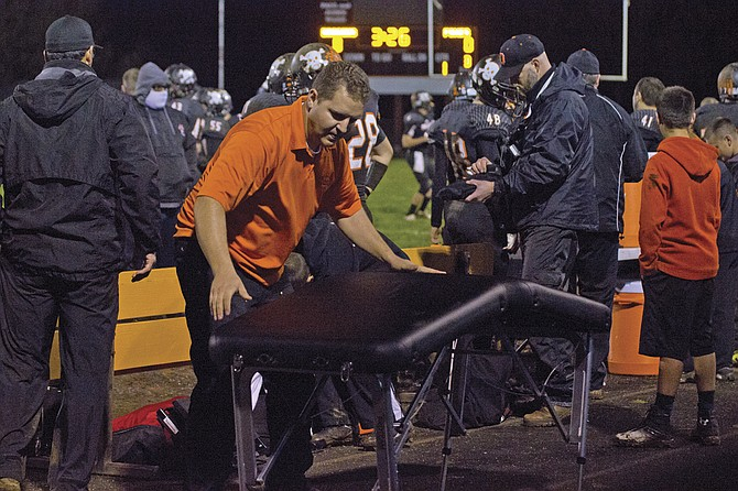 Brent Darrington prepares his station in case of an injury occurring.