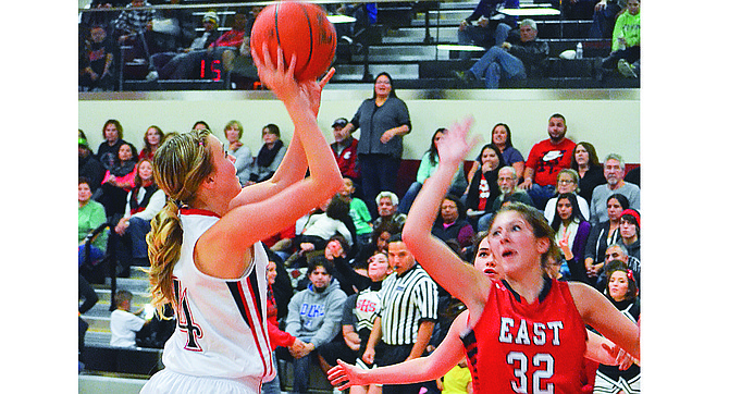 After a convincing 76-56 season-opening win last Friday over visiting East Valley, the Lady Grizzly basketball team made it a weekend sweep with a 65-55 victory at Pasco. Pictured is Sunnyside's Summer Hazzard driving the key for a shot on Friday against East Valley's Bayleigh Harris. On Friday, Liddy Valle and Jessica Mendoza led Sunnyside in scoring with 16 and 13 points, respectively. On Saturday, Emilee Maldonado and Selena Rubalcava tallied 17 and 15 points, respectively, to lead Sunnyside. Jordan Rodriguez had a combined 23 points in the two contests. Coach Rick Puente said defense was the key to victory in both games, especially on Saturday when the Lady Grizz used a 19-7 run in the second quarter to rally from an early deficit. Sunnyside hosts Lower Valley rival Grandview tomorrow, Tuesday.