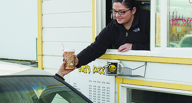 Samantha Zamora, the new owner of the Daily Buzz in Sunnyside, hands a drink to a customer. Zamora, who has worked at the coffee stand for the past two years, took over the business on Jan. 2. She has kept the menu intact but added bagels and hopes to add some other pastries and breakfast burritos soon. The Daily Buzz is open Monday to Friday, 6 a.m. to 5 p.m., and weekends from 8 a.m. until noon.