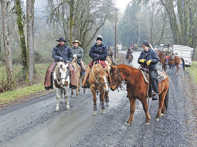 Dusty Dodson, Dave Dodson, Samantha Young and Tracy Young, left to right, hit the trail on Saturday morning for the Polk County Saddle-ites' annual New Year's Ride in Pedee. With freezing temperatures gone, the ice had melted and turned to mud for much of the trail through the hills. Neither the horses nor riders seemed to mind. About 25 riders came from throughout the Willamette Valley to participate in the annual event, which includes a chili feed and bonfire to warm up after the one-and-a-half hour ride.
