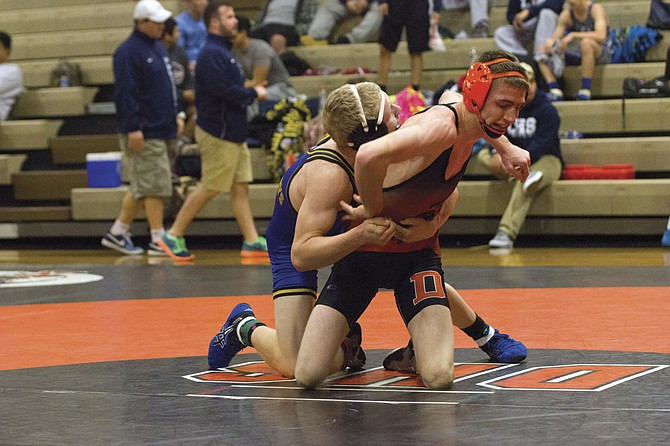 Nolan Miller attempts to break free during the Brunner Invitational at Dallas High on Saturday.