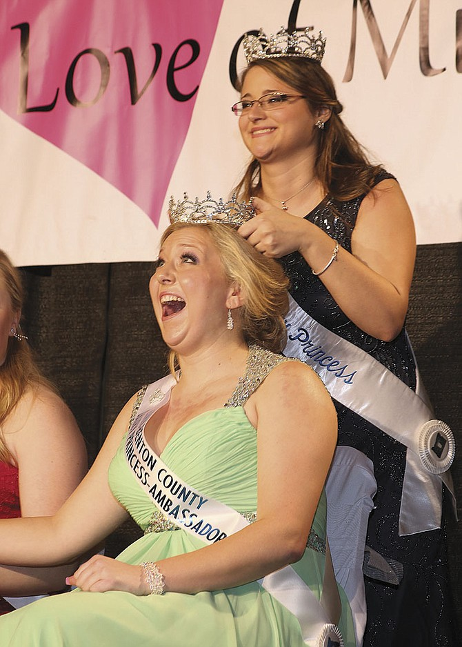 Emma Miller of Independence reacts as she is crowned the 2015 Oregon Dairy Princess-Ambassador on Jan. 17 by 2014 Princess-Ambassador Danielle Bull.