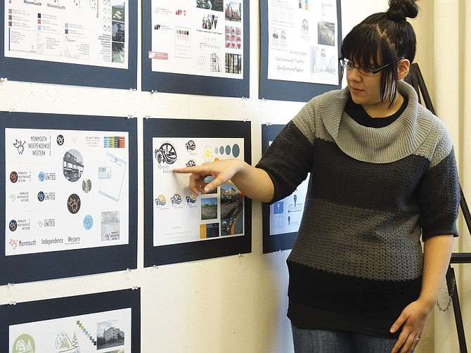 Kimberly Apilado critiques the logo she designed for Monmouth and Independence during her graphic arts class on Thursday.