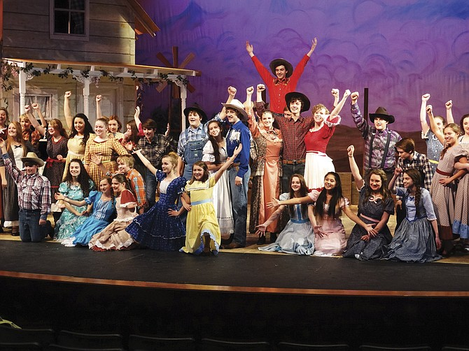 """The cast of """"Oklahoma!"""" pauses for a big finish after singing the musical's namesake theme song about the territory."""