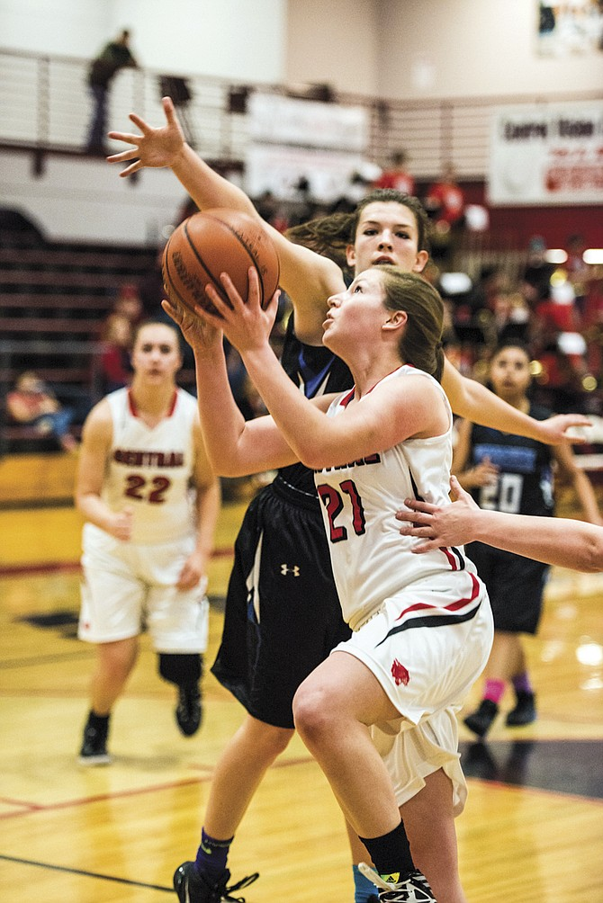 Central junior Kylie Nash looks to drive past a Woodburn defender on Friday. Nash scored 24 points.