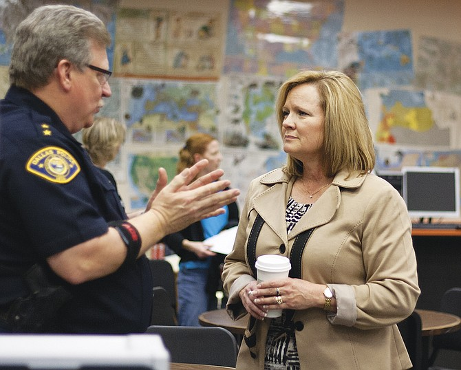 Dallas Police Chief Tom Simpson speaks with Michelle Johnstone during a meet-and-greet at Dallas High School on March 5.