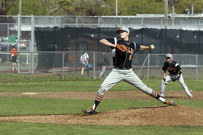 Dallas pitcher Logan Hatley strikes out 12 batters against Woodburn on Thursday.