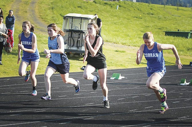Perrydale junior Taylor Price (center) recorded one of Class 2A's fastest 300-meter hurdle times so far this season.