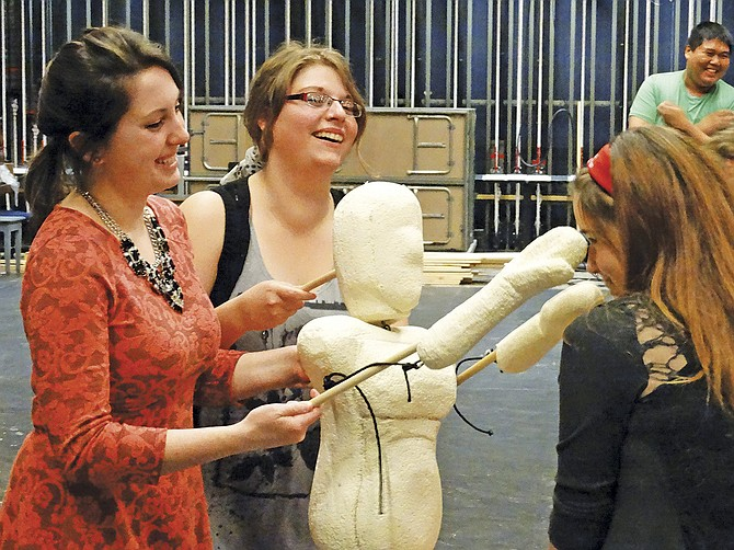 """Becky Bond and Stephanie Kintz practice making the movements of their puppet seem natural during a rehearsal for """"Frankie's Flights of Fancy,"""" Western Oregon University's spring play. The play was written by students, including Belladina Starr, who plays Frankie. It is a family friendly play, and opens at 7 p.m., May 27 though May 30 at Rice Auditorium. See the May 27 edition of the I-O for a full preview."""