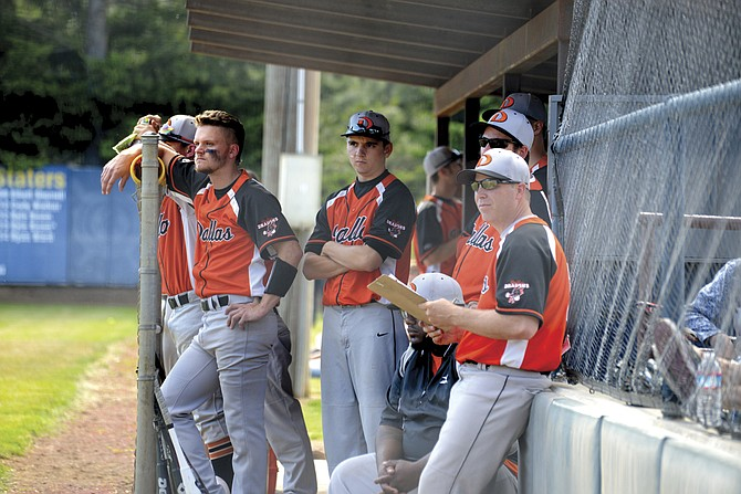 Dallas players and coaches look on during the team's 5-0 loss to Hood River Valley on May 27.