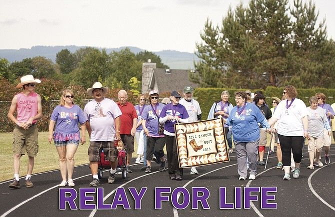 """Survivors and caregivers kick off Relay for Life Polk County 2015 with the """"survivor lap,"""" honoring those who are battling or have beaten cancer."""