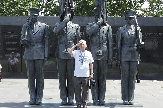 Leonard Lonigan salutes at the statue at the U.S. Air Force memorial during a Honor Flight trip to Washington, D.C.  He was on a B-24 bomber crew during World War II.