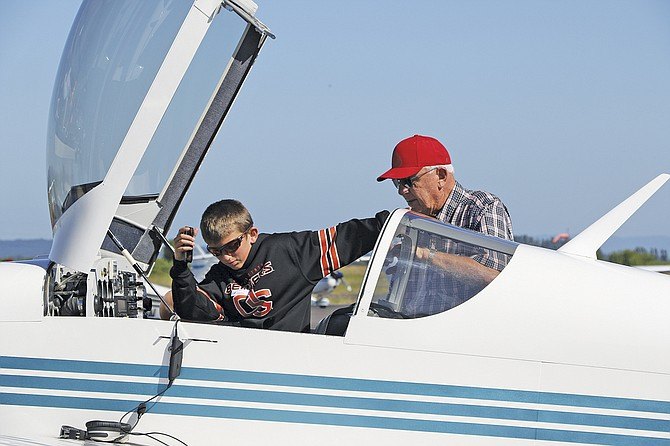 Mason Martin prepares for his flight during the Experimental Aircraft Association's Young Eagles program on Saturday morning. Young Eagles, launched in 1992, is aimed at getting youths aged 8 to 17 the chance to learn about aviation.