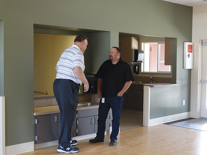 Buzz Brazeau and Brent DeMoe tour the infant-toddler center on Thursday.
