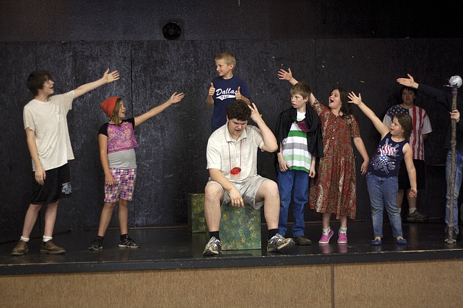 "The cast of ""King Arthur's Quest"" sing a musical number during rehearsal on Thursday. Missoula Children's Theatre led a five-day camp beginning June 22 to produce the musical in Falls City, coordinated through the school district's after school program FACES."