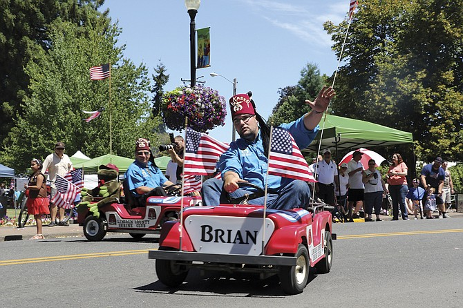 The Shriners drive their cars in the Monmouth-Independence Rotary Club Grand Parade on Saturday, decked out in American flags. Hundreds lined the streets of Monmouth and Independence to watch the parade go by.