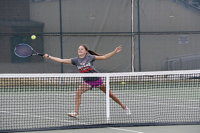 Adelaine Gillette returns a hit during the Monmouth-Independence Tennis Tournament on Saturday morning.