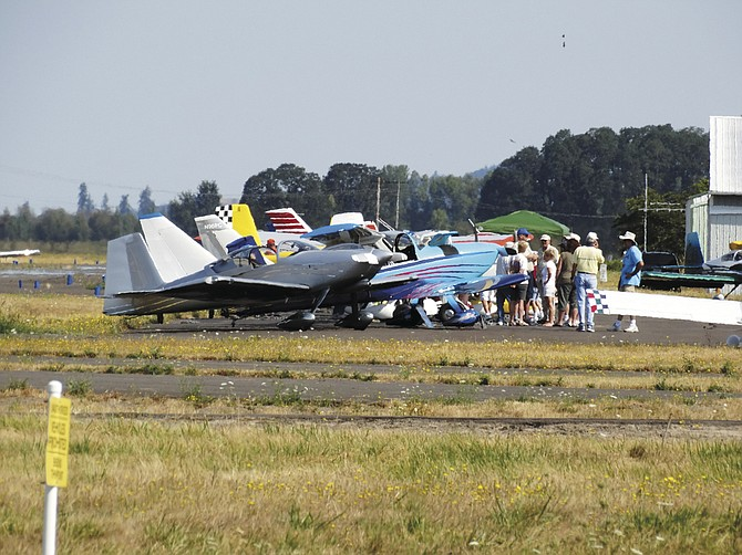 Crowds take a walk around the tarmac at Independence State Airport during the annual fly-in last year.