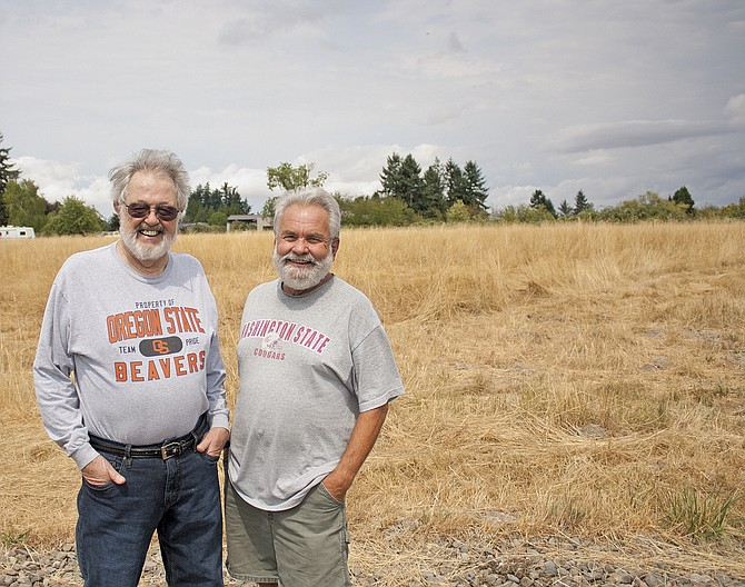Norm Silvey and Jim Schmaltz are displeased in the way a neighbor's tall, dry weeds are being handled.