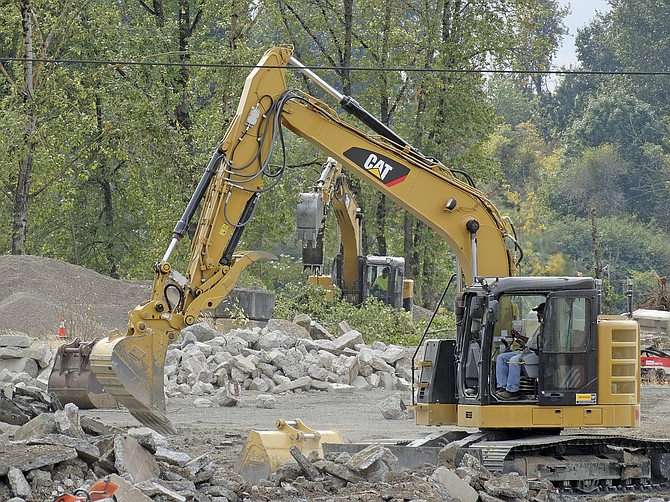 Demolition continues as workers make the old Valley Concrete site on the Willamette River shovel-ready for whichever developer the city decides to sell it to.