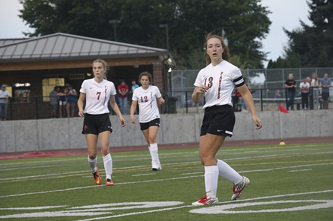 Senior co-captain Naomi Torres (13) watches a play unfold during Central's match against North Eugene.