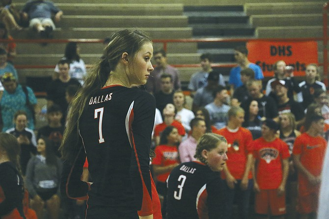 At 6-foot-5, Dallas sophomore Tristin Savage stands nearly a foot taller than her teammates on varsity, including Courtney Heggstrom.