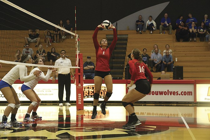 Western Oregon freshman setter Leila Holt looks to set her teammates up for a kill during the Wolves' match against Alaska Fairbanks on Saturday.  Western Oregon won 25-22, 25-19, 25-19 for its first Great Northwest Athletic Conference win.