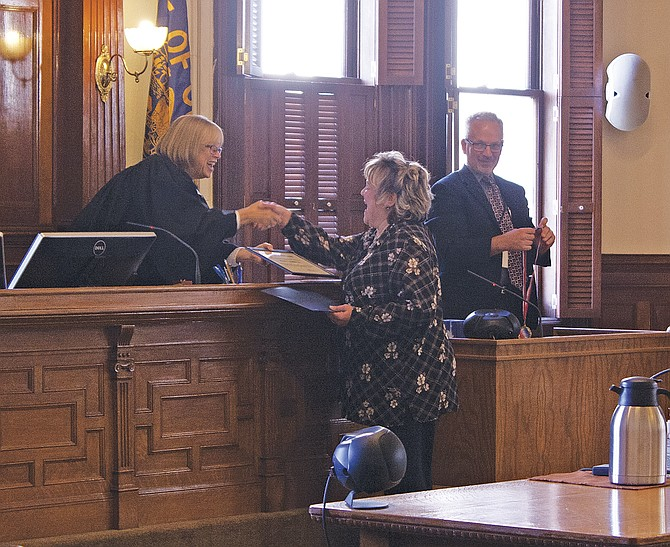 Polk County Circuit Court Judge Sally Avera (left) congratulates Suzan Vanhoute on her graduation from the Polk County Drug Court program on Sept. 28. There were five graduates honored: Shane Morgan, Dominique Breese, Francisco Pedraza-Hernandez and Deborah Kennedy.