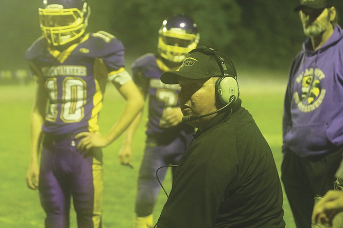 Falls City coach Laric Cook talks to players during the Mountaineers' 36-32 loss on Friday night.