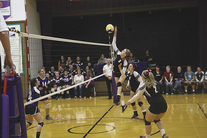 Taylor Price goes up for a kill against Falls City.