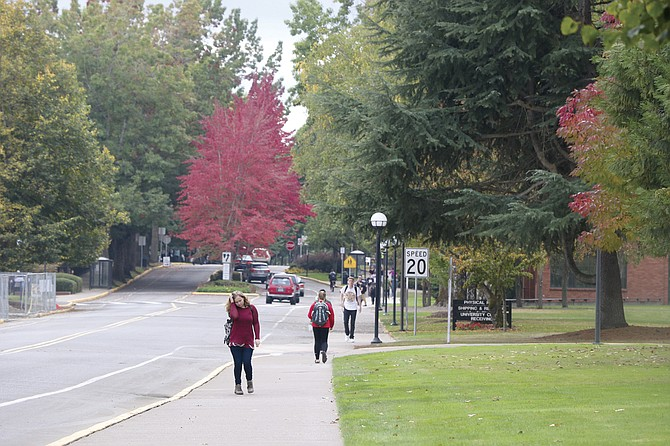 Students walk about Western Oregon's campus on Friday afternoon.