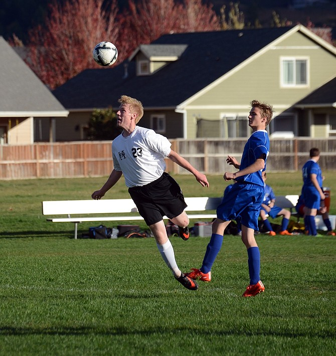 Cody Lingel leaps for a header during the first half of Monday's game.