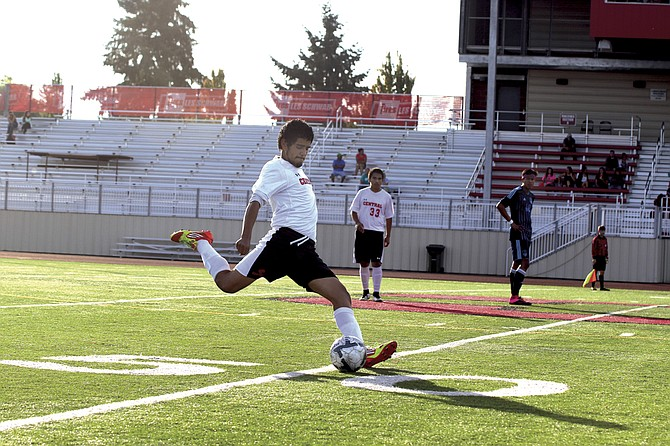 Senior defender Alfredo Diaz looks to send a kick up field during Central's 1-0 victory over Corvallis on Friday.