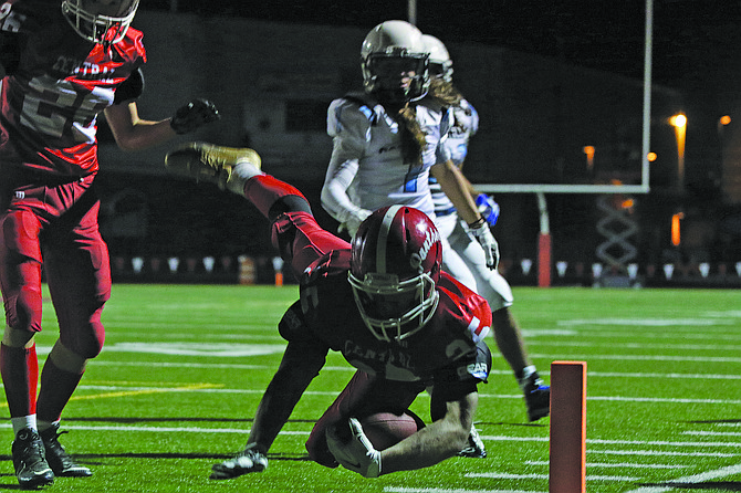 Central's Alvin Berroa dives for a touchdown on Friday.