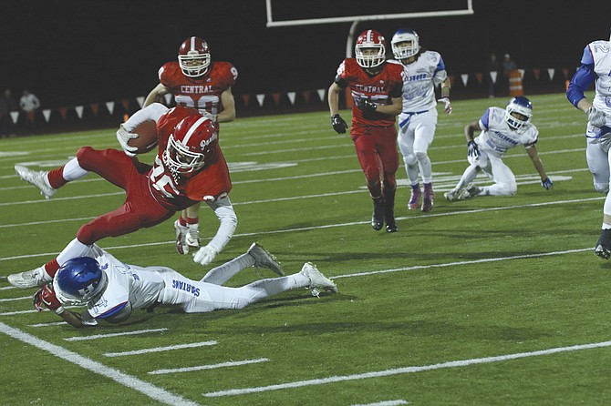 Receiver Peter Mason attempts to elude a tackler during Central's 46-28 victory over Hillsboro on Friday evening.