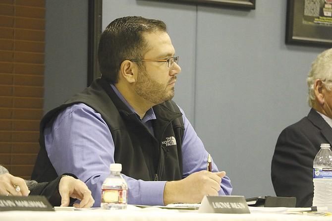 Dallas City Councilor Micky Garus listens to testimony.