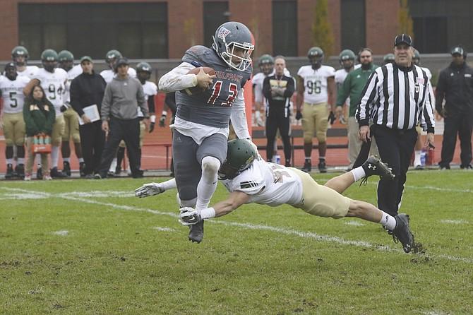 LUKAS EGGEN/Itemizer-Observer Quarterback Phillip Fenumiai attempts to escape a tackle against Humboldt State.
