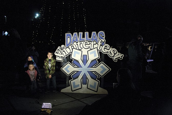 Kids eagerly await Santa Claus who will be visiting Dallas Winterfest on Friday.