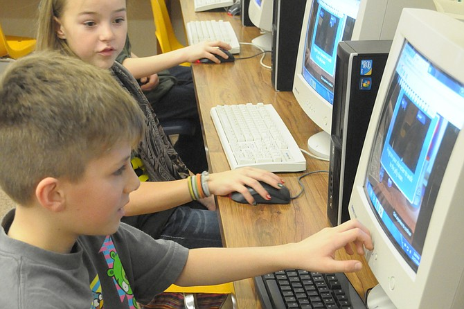 Grangeville Elementary Middle School students work on coding in the computer lab.