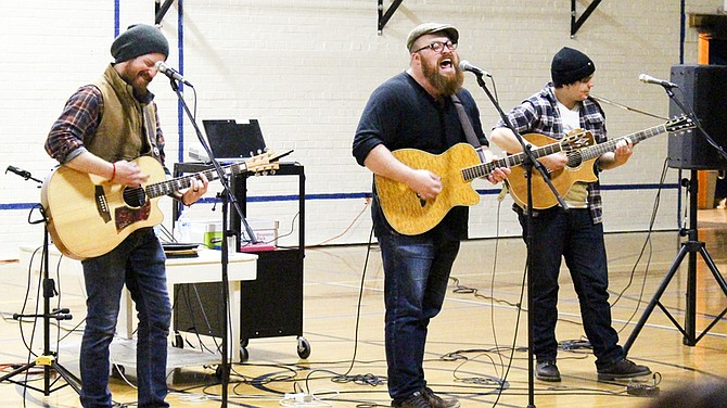 """""""The Voice"""" finalist Austin Jenckes (center) performs with fellow band members Cody Beebe and Skylar Mehal (left to right) last Friday in a Grandview School District–sponsored Musician in Residence concert."""