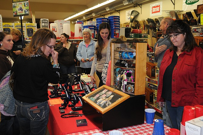 Ladies Night Out at CHSPrimeland's County Store in Grangeville saw a large crowd Thursday, Dec. 3. The night included manager, John Lamb, doing KORT radio spots with owner, Jim Nelley, and employee, Melinda Hall.