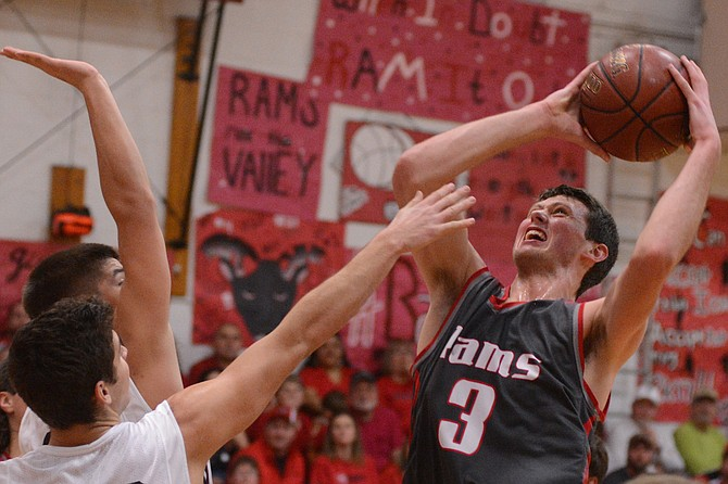 Clearwater Valley's Grant Wallace buried Kamiah during the second half, tallying 11 of his 17 points after intermission last Friday night, Dec. 11, at the Upriver Rampage. Wallace is pictured shooting over Kamiah's Chris Pethtel and Kaleb Oatman.