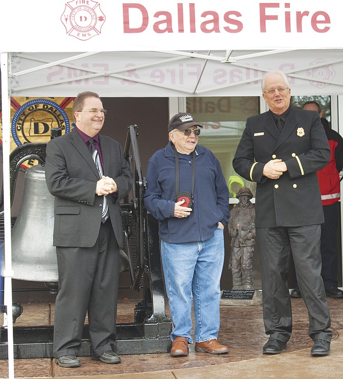 Delbert Fredricks, center, was surprised Friday when Dallas Fire & EMS dedicated its new fire bell in honor of his 64 years of service to the department. Here, volunteer firefighter Mike Bollman, left, and Dave Pedersen, fire chaplain, tell stories about Fredricks' dedication to the department. Several individuals and businesses donated time and money to the project, including Boy Scout Troop No. 288 and Eagle Scout Breydn Banford, the Banford family, Liberty Concrete, Ewing Irrigation and Landscape Supply, JB Instant Lawn and Nursery, DC Electric, Cathy and Larry Dunlap and the city of Dallas. 