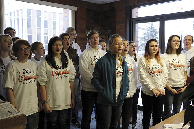 The Dallas High School choir sings Christmas carols on Dec. 8. The choir visited local businesses to spread some holiday cheer to the community.